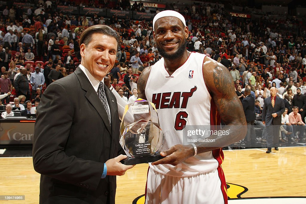 Nick Verna, Southern Region DSM of Kia Motors America presents LeBron James #6 of the Miani Heat with the Eastern Conference Kia Player of the Month award prior to the game against the Sacramento Kings on February 21, 2012 at American Airlines Arena in Miami, Florida.