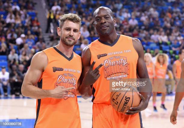 Nick Viall and Simeon Rice attend 50K Charity Challenge Celebrity Basketball Game at UCLA's Pauley Pavilion on July 17 2018 in Westwood California