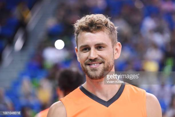 Nick Viall plays basketball at Monster Energy Outbreak Presents $50K Charity Challenge Celebrity Basketball Game at UCLA's Pauley Pavilion on July 17...