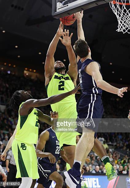 Nick Victor of the Yale Bulldogs blocks a shot by Rico Gathers of the Baylor Bears in the first half of their game during the first round of the 2016...