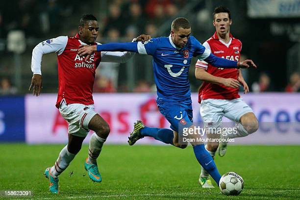 Nick Viergever and Giliano Wijnaldum of AZ and Luc Castaignos of Twente battle for the ball during the Eredivisie match between AZ Alkmaar and FC...