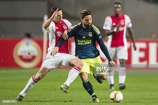 Nick Viergever of Ajax Diego Ribas da Cunha of Fenerbahce during the UEFA Europa League match between Ajax and Fenerbahce on November 5 2015 at the...