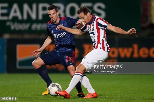 Nick Viergever of Ajax Freek Heerkens of Willem II during the Dutch Eredivisie match between Willem II v Ajax at the Koning Willem II Stadium on...