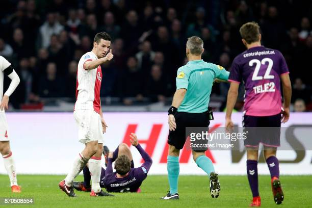 Nick Viergever of Ajax Referee Bjorn Kuipers during the Dutch Eredivisie match between Ajax v FC Utrecht at the Johan Cruijff Arena on November 5...
