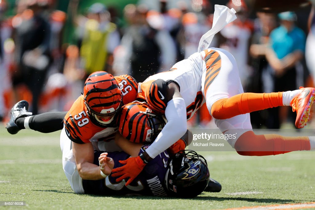 Nick Vigil #59 of the Cincinnati Bengals and George Iloka #43 of the Cincinnati Bengals combine to tackle Danny Woodhead #39 of the Baltimore Ravens during the first quarter at Paul Brown Stadium on September 10, 2017 in Cincinnati, Ohio.