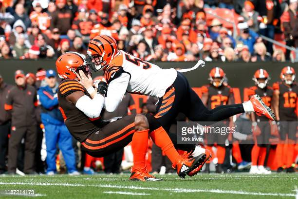 Nick Vigil of the Cincinnati Bengals forces a fumble by David Njoku of the Cleveland Browns during the first quarter at FirstEnergy Stadium on...