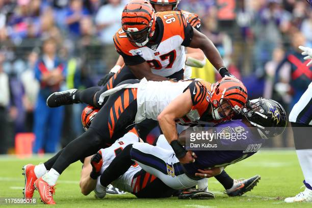 Nick Vigil of the Cincinnati Bengals tackles Lamar Jackson of the Baltimore Ravens during the first half at M&T Bank Stadium on October 13, 2019 in...