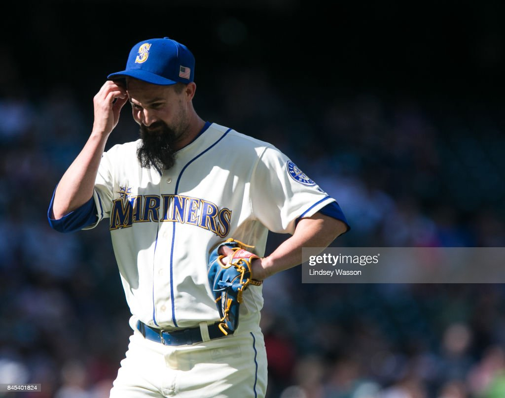 Nick Vincent #50 of the Seattle Mariners scratches his head as he's taken out of the game in the eighth inning after giving up a two RBI double to Justin Upton #9 of the Los Angeles Angels of Anaheim at Safeco Field on September 10, 2017 in Seattle, Washington.