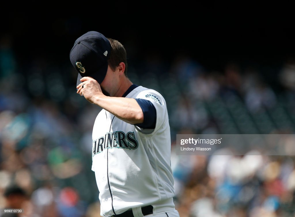 Nick Vincent #50 of the Seattle Mariners walks off of the field after giving up a ground rule double to Jurickson Profar #19 of the Texas Rangers in the ninth inning at Safeco Field on May 16, 2018 in Seattle, Washington. The Texas Rangers beat the Seattle Mariners 5-1.
