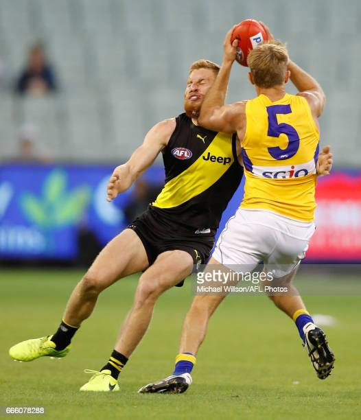 Nick Vlastuin of the Tigers and Brad Sheppard of the Eagles collide during the 2017 AFL round 03 match between the Richmond Tigers and the West Coast...
