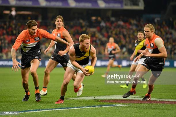 Nick Vlastuin of the Tigers controls the ball during the round 17 AFL match between the Greater Western Sydney Giants and the Richmond Tigers at...