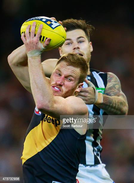 Nick Vlastuin of the Tigers is tackled by Jamie Elliott of the Magpies during the round seven AFL match between the Richmond Tigers and the...