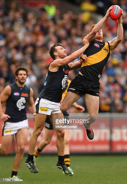 Nick Vlastuin of the Tigers marks the ball against Brock McLean of the Blues during the round 21 AFL match between the Richmond Tigers and the...
