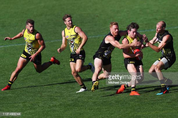 Nick Vlastuin of the Tigers tackles Jack Ross of the Tigers during the Richmond 2019 Jumper Presentation and AFL Practice Match at Punt Road Oval on...