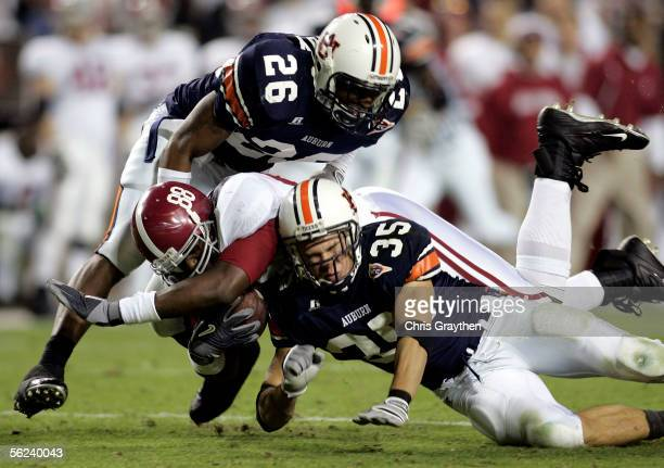 Nick Walker of the University of Alabama is tackled by Steve Gandy and Will Herring of Auburn University on November 19 2005 at JordanHare Stadium in...