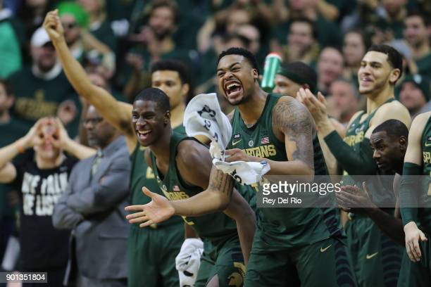 Nick Ward and Jaren Jackson Jr #2 of the Michigan State Spartans celebrate from the bench during the game against the Maryland Terrapins at Breslin...