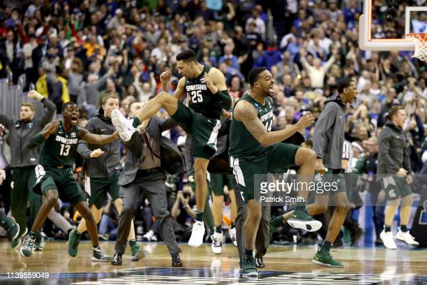 Nick Ward and Kenny Goins of the Michigan State Spartans celebrate their teams 68-67 win over the Duke Blue Devils in the East Regional game of the...