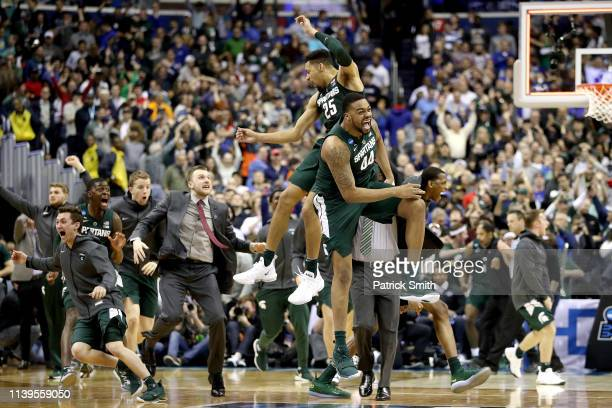 Nick Ward and Kenny Goins of the Michigan State Spartans celebrate their teams 6867 win over the Duke Blue Devils in the East Regional game of the...
