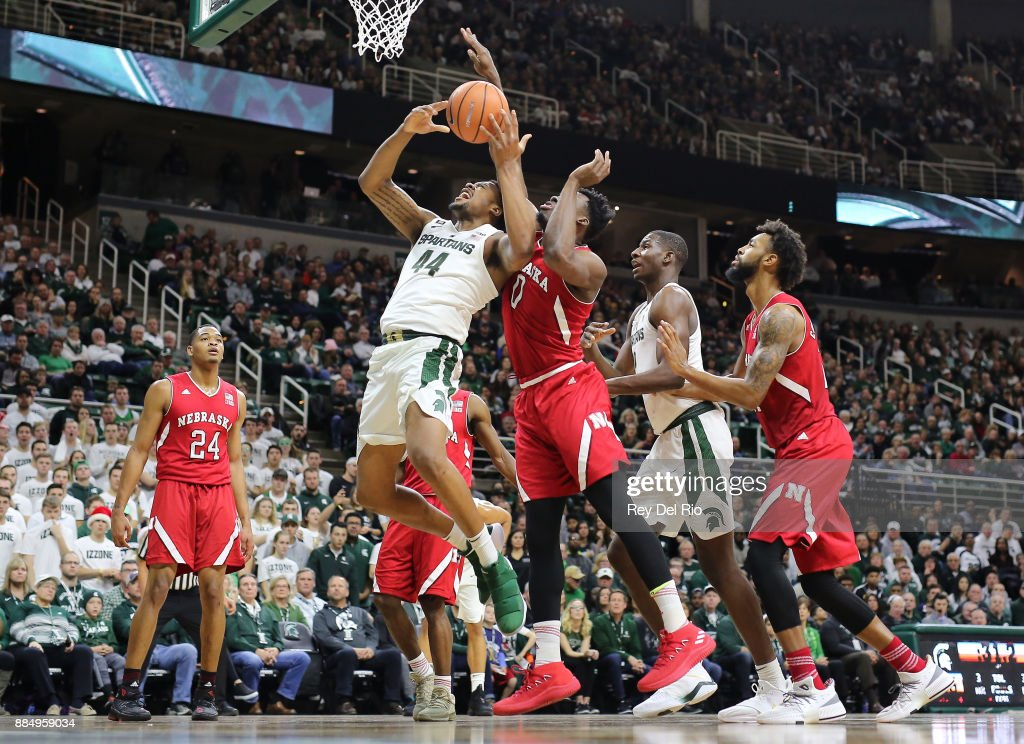 Nick Ward goes up for as shot and draws a foul from Duby Okeke #0 of the Nebraska Cornhuskers at Breslin Center on December 3, 2017 in East Lansing, Michigan.