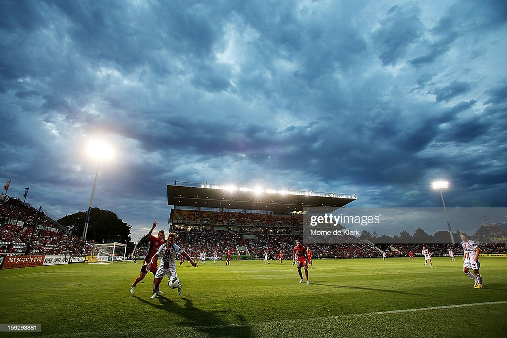 Nick Ward of Perth holds off Daniel Bowles of Adelaide during the round 16 A-League match between Adelaide United and the Perth Glory at Hindmarsh Stadium on January 11, 2013 in Adelaide, Australia.