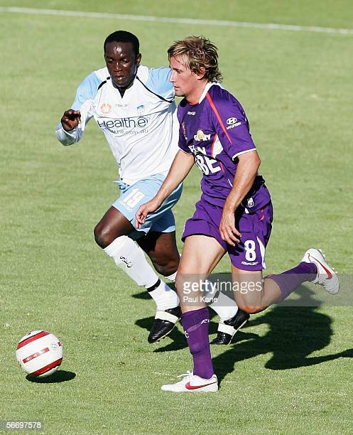 Nick Ward of the Glory contests the ball with Dwight Yorke of Sydney during the round 20 ALeague match between Perth Glory and Sydney FC held at...