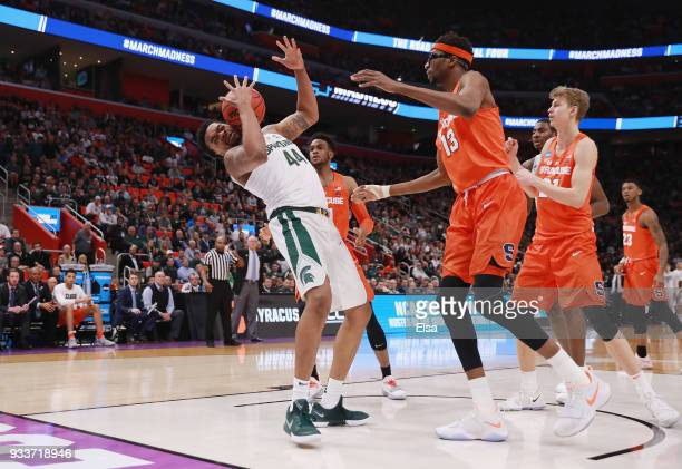 Nick Ward of the Michigan State Spartans battles for a rebound with Paschal Chukwu of the Syracuse Orange during the first half in the second round...