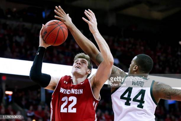 Nick Ward of the Michigan State Spartans blocks a shot attempt by Ethan Happ of the Wisconsin Badgers in the first half at the Kohl Center on...
