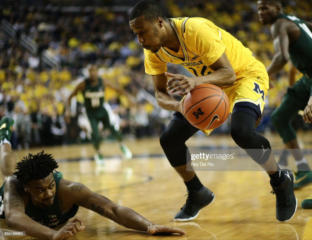 Nick Ward #44 of the Michigan State Spartans dive after a loose ball against Muhammad-Ali Abdur-Rahkman #12 of the Michigan Wolverines in the in the second half at Crisler Arena on February 7, 2017 in Ann Arbor, Michigan.