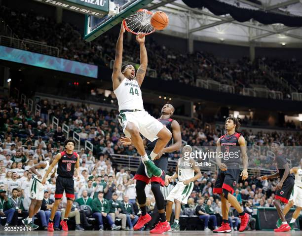 Nick Ward of the Michigan State Spartans dunks the ball during a game against the Rutgers Scarlet Knights at Breslin Center on January 10 2018 in...