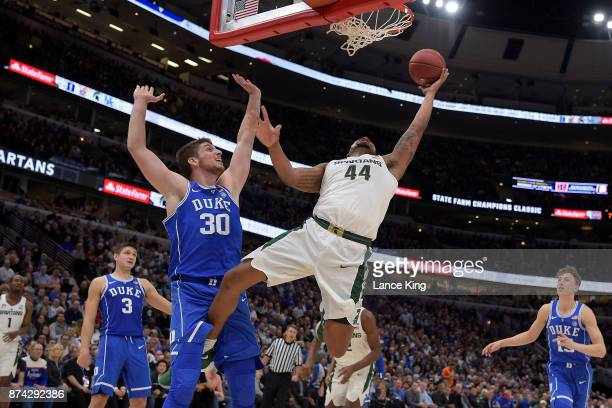Nick Ward of the Michigan State Spartans goes to the basket against Antonio Vrankovic of the Duke Blue Devils during the Champions Classic at United...