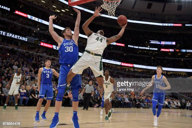 Nick Ward of the Michigan State Spartans puts up a shot against Antonio Vrankovic of the Duke Blue Devils during the Champions Classic at United...
