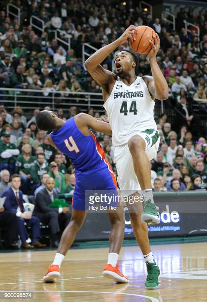 Nick Ward of the Michigan State Spartans shoots a layup against John Grant Jr #4 of the Savannah State Tigers at Breslin Center on December 31 2017...