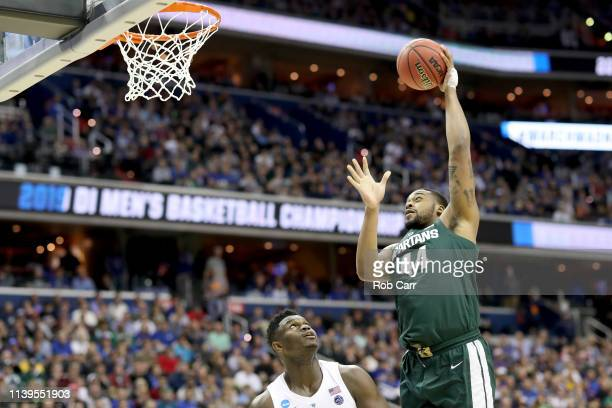 Nick Ward of the Michigan State Spartans shoots the ball against Zion Williamson of the Duke Blue Devils during the second half in the East Regional...
