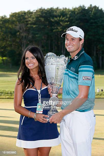 Nick Watney and his wife Amber celebrate with the trophy after NIck won the tournament following the final round of The Barclays at the Black Course...