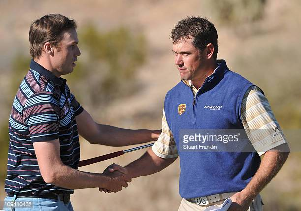 Nick Watney and Lee Westwood of England shake hands on the 18th hole during the second round of the Accenture Match Play Championship at the...
