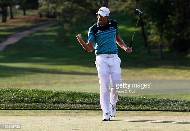 Nick Watney celebrates after he made a birdie putt on the 18th hole green to win the tournament the final round of The Barclays at the Black Course...