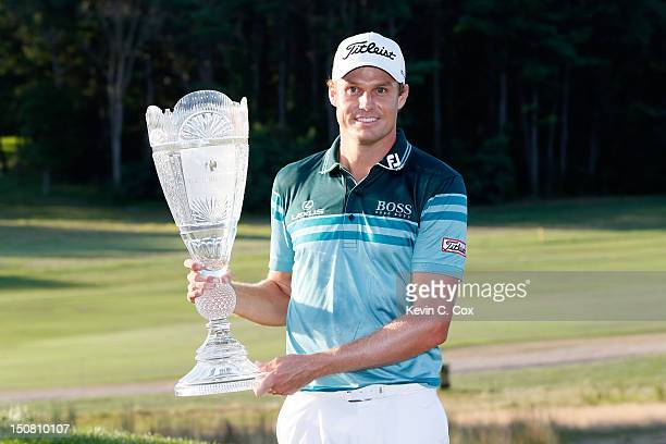 Nick Watney celebrates with the trophy after he won the tournament following the final round of The Barclays at the Black Course at Bethpage State...
