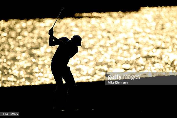 Nick Watney hits an approach shot on the 18th hole during the second round of THE PLAYERS Championship held at THE PLAYERS Stadium course at TPC...