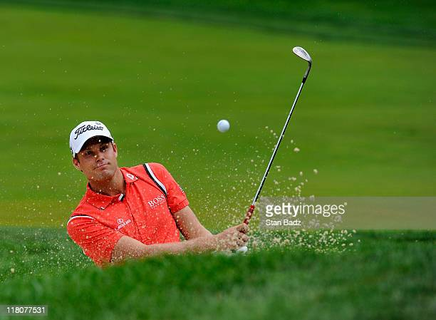 Nick Watney hits out of a bunker onto the fourth green during the final round of the ATT National at Aronimink Golf Club on July 3 2011 in Newtown...