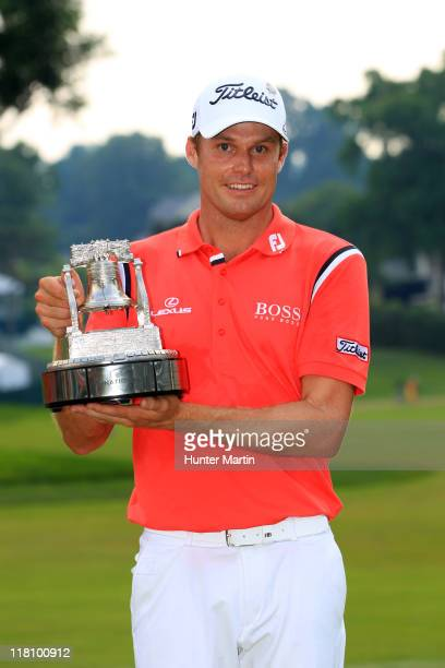 Nick Watney holds the championship trophy after winning the ATT National at Aronimink Golf Club on July 3 2011 in Newtown Square Pennsylvania