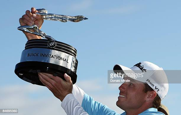 Nick Watney holds the winners trophy after his -11 under par victory during the Final Round of the Buick Invitational at the Torrey Pines North...