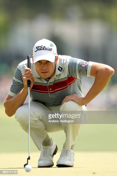 Nick Watney lines up a putt on the first green during the third round of the 2010 Masters Tournament at Augusta National Golf Club on April 10 2010...