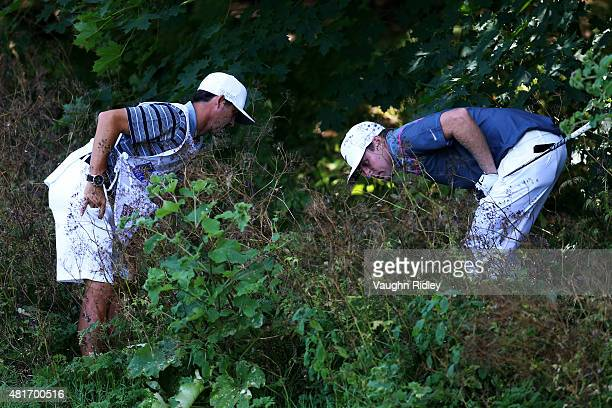 Nick Watney looks for his ball on the 13th hole during round one of the RBC Canadian Open on July 23 2015 at Glen Abbey Golf Club in Oakville Canada