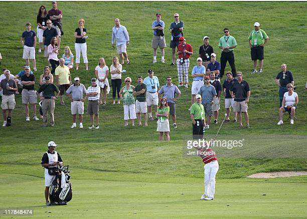 Nick Watney makes his approach shot onto the 17th green during round three of the Travelers Championship at TPC River Highlands on June 25 2011 in...