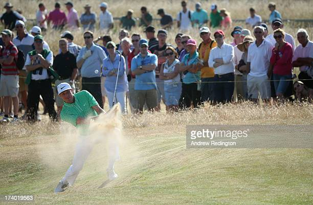 Nick Watney of the United States hits a shot on the 10th hole during the second round of the 142nd Open Championship at Muirfield on July 19 2013 in...