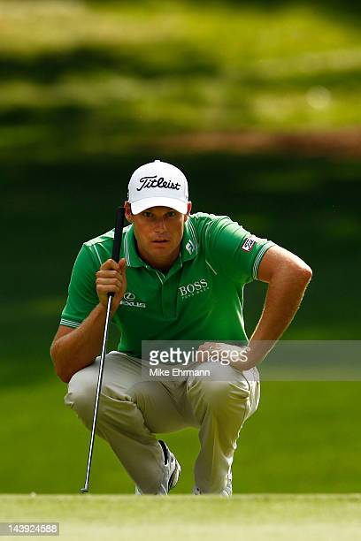 Nick Watney of the United States lines up his putt on the 12th green during the third round of the Wells Fargo Championship at the Quail Hollow Club...