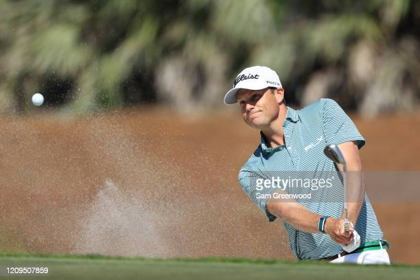 Nick Watney of the United States plays a shot from a bunker on the third hole during the third round of the Honda Classic at PGA National Resort and...