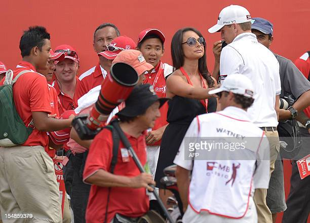 Nick Watney of the US is greeted by his wife Amber Watney after winning the 61 million USD CIMB Classic golf tournament at The Mines Resort and Golf...