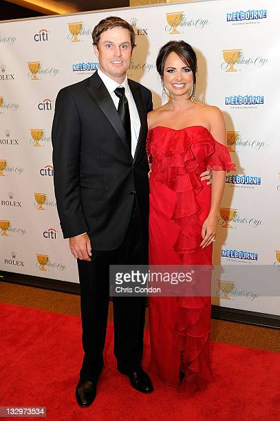 Nick Watney of the US Team and his wife Amber Watney arrive on the red carpet at the Gala Celebration for the 2011 Presidents Cup at the Crown Towers...