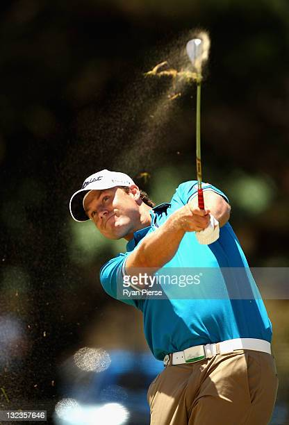 Nick Watney of the USA hits his second shot on the 4th Hole during day three of the 2011 Emirates Australian Open at The Lakes Golf Club on November...